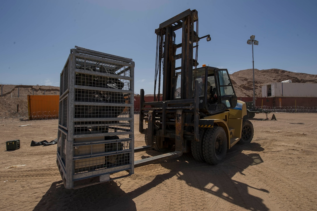 Builder 2nd Class Dustin Baugus, assigned to Commander, Task Group 56.2, Naval Mobile Construction Battalion One, moves packed materials in preparation for the end of Exercise Eager Lion 2017. Eager Lion is an annual U.S. Central Command exercise in Jordan designed to strengthen military-to- military relationships between the U.S., Jordan and other international partners. This year's iteration is comprised of about 7,200 military personnel from more than 20 nations that will respond to scenarios involving border security, command and control, cyber defense and battlespace management. (U.S. Navy Combat Camera photo by Mass Communication Specialist 2nd Class Austin L. Simmons)