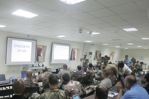Jordanian Army officer Lt. Mohammad Alkhawaldeh, center, gives a communications brief at the higher command center during exercise Eager Lion, May 15, at the Joint Training Center in Jordan. Eager Lion 2017 is an annual U.S. Central Command exercise in Jordan designed to strengthen military-to-military relationships between the U.S., Jordan and other international partners. This year's iteration is comprised of about 7,200 military personnel from more than 20 nations that will respond to scenarios involving border security, command and control, cyber defense and battlespace management.  (Photo by Moath Aleen, Jordanian Army).