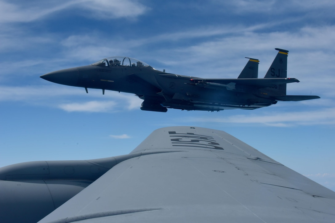 A 336th Fighter Squadron F-15E Strike Eagle flies near a KC-135R Stratotanker, May 18, 2017, in the skies over Seymour Johnson Air Force Base, North Carolina. The Wings Over Wayne Air Show will feature Strike Eagle formation flights during the two-day free event, May 20-21, 2017. (U.S. Air Force photo by Airman 1st Class Kenneth Boyton)