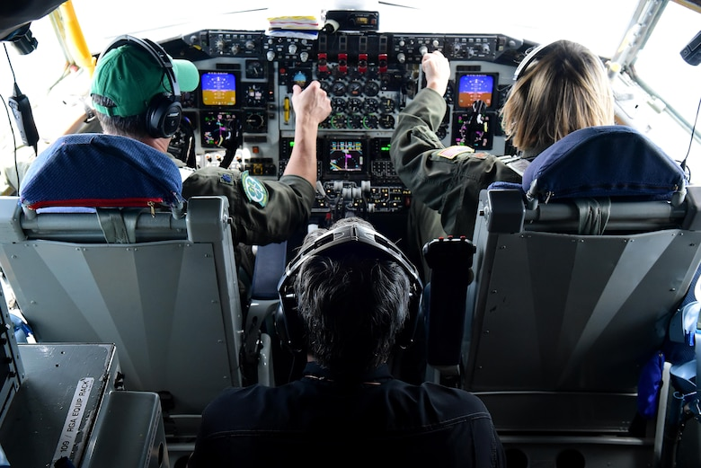 Lt. Col. Wayne Turner and Maj. Amanda Person, 77th Air Refueling Squadron, KC-135R Stratotanker pilots, fly civic leaders including Lt. Governor of North Carolina, Dan Forest, May 18, 2017, in the skies over Seymour Johnson Air Force Base, North Carolina. The flight occurred two days prior to the opening ceremony of Wings Over Wayne Air Show, which will headline the U.S. Navy Blue Angels premiere aerial demonstration team. (U.S. Air Force photo by Airman 1st Class Kenneth Boyton)