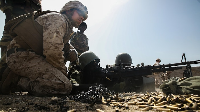 Cpl. Robert Piedra, a rifleman with Special Purpose Marine Air-Ground Task Force – Crisis Response – Africa, coaches a member of Senegal's Compagnie Fusilier de Marin Commando fire the M60 Machinegun during a known distance range at Thies, Senegal, May 2, 2017.  Marines with SPMAGTF-CR-AF and the COFUMACO conducted a four-week training exercise that included advanced combat firing techniques, a machine gun range and a live-fire platoon attack range.