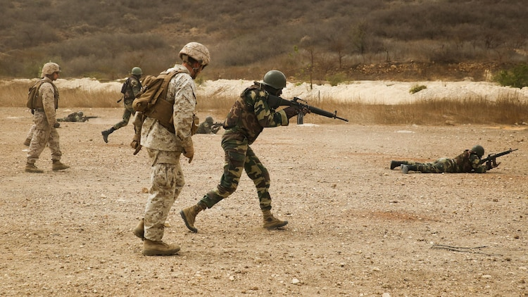 U.S. Marines with Special Purpose Marine Air-Ground Task Force – Crisis Response – Africa coach members of Senegal's Compagnie Fusilier de Marin Commando during a fire and maneuver range at Thies, Senegal, May 3, 2017.  Marines with SPMAGTF-CR-AF and the COFUMACO conducted a four-week training exercise that included advanced combat firing techniques, a machine gun range and a live-fire platoon attack range.