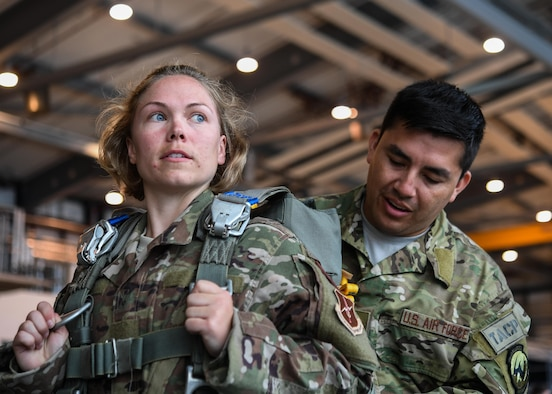 Tech Sgt. Cortney Velez, 435th Contingency Response Support Squadron independent duty medical technician and Master Sgt. David Galindo, 2nd Air Support Operations Squadron operations superintendent, prepare gear prior to a personnel drop over Alzey, Germany, May 12, 2017. Velez completed her first jump with the 435 CRG and is U.S. Air Forces in Europe's first female airborne IDMT. (U.S. Air Force by Staff Sgt. Nesha Humes)