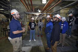 John Bell, hydropower operator trainee, explains to a group of high school and college students in the control room about procedures and how water passes through generating units using a gravity-fed system at the Old Hickory Dam Hydropower Plan in Hendersonville, Tenn., Thursday, May 4, 2017.