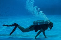 A reconnaissance Marine participates in the United States Marine Corps Combatant Divers Course, on Camp Schwab, Okinawa, Japan, May 11, 2017. A mobile training team from Navy Diving and Salvage Training Center, Panama City, Florida, conducted the training. The USMC Combatant Divers Course is eight weeks and combines lectures, demonstrations and practical application of circuit diving, diving physics, and medical aid. The Marine is with 3rd Reconnaissance Battalion, 3rd Marine Division, III Marine Expeditionary Force.