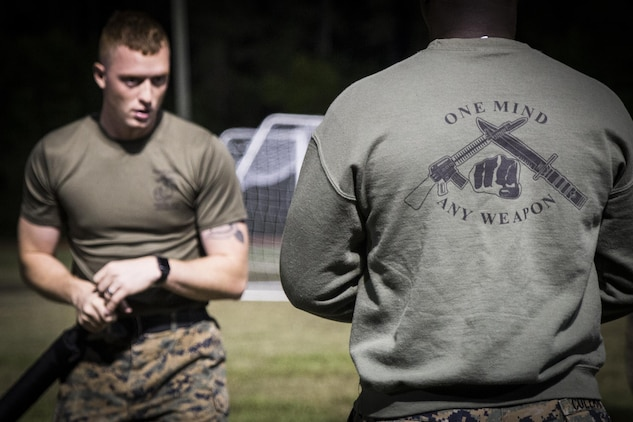 Cpl. Jamie Brooks instructs A Marine to prepare him for a Marine Corps Martial Arts belt test aboard Marine Corps Air Station Beaufort, May 15. Brooks is a MCMAP Instructor and sports coach. He spends two hours every morning teaching Marines MCMAP and volunteers for an hour after work three times a week to coach a youth sports team. He also spends one weekend a month volunteering at events in the local Beaufort community. Brooks is an administrative specialist with Headquarters and Headquarters Squadron.