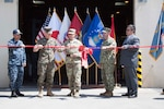 DLA Distribution commanding general Brig. Gen. John Laskodi (center) cuts the ribbon on the network's newest facility in Iwakuni, Japan, alongside (left to right) Navy Cmdr. Nolasco Villanueva, commander, DLA Distribution Yokosuka, Japan; Marine Corps Col. Richard Fuerst, commander, Marine Corps Air Station Iwakuni; Navy Capt. Tim Daniels, commander, DLA Pacific; and Thelmo Santos, site director, DLA Distribution Iwakuni.