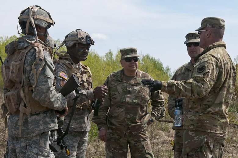 Cmd. Sgt. Maj. Ted Copeland, command sergeant major of the Army Reserve, speaks to Army Reserve Soldiers with the 993rd Transportation Company, based in Tampa, Florida, on May 18 in Camp Wainwright, Alberta, Canada, during Maple Resolve 17. More than 650 U.S. Army Soldiers are supporting Maple Resolve 17, the Canadian Army's premiere brigade-level validation exercise running May 14-29 at Camp Wainwright. As part of the exercise, the U.S. Army is providing a wide array of combat and support elements. These include sustainment, psychological operations, public affairs, aviation and medical units. (U.S. Army Reserve photo by Staff Sgt. Michael Crawford)