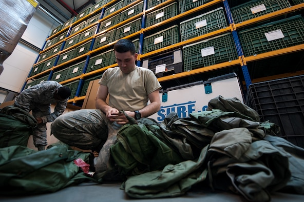 Airman Austin Smith, 86th Logistics Readiness Squadron fuels journeyman, right, and Airman 1st Class Adam Evans III, 86th LRS individual protective equipment journeyman, inventory equipment at the IPE warehouse on Ramstein Air Base, Germany, May 19, 2017. IPE is responsible for maintaining equipment that is used to protect Airmen from chemical, biological, radiological, nuclear and explosive materials. (U.S. Air Force photo by Senior Airman Devin Boyer)