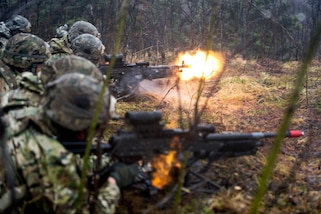 Soldiers fire M240 machine guns at targets down range during exercise Northern Edge at Fort Greely, Alaska, May 10, 2017. Air Force photo by Airman 1st Class Isaac Johnson