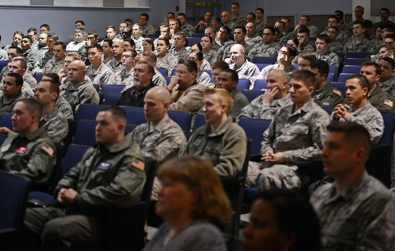 Members of Team McChord sit in on the 62nd Airlift Wing all-call at the McChord theater May 17, 2017 at Joint Base Lewis-McChord, Wash. During the all-call, Airmen were allowed to ask questions utilizing a phone application that allowed Airmen to text in their questions and receive immediate answers. (U.S. Air Force photo/Senior Airman Divine Cox)