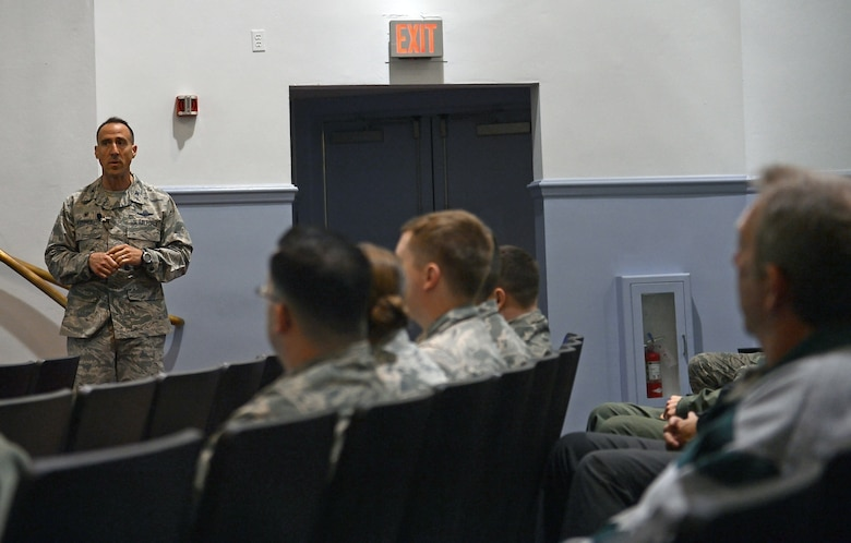 Col. Leonard Kosinski, 62nd Airlift Wing commander, speaks to members of Team McChord during an all-call at the base theater May 17, 2017 at Joint Base Lewis-McChord, Wash. Kosinski used this time as an opportunity to talk about important announcements and information affecting Team McChord. He also spoke on McChord's mission and resiliency, and ended the all call with a question-and-answer session. Utilizing a phone application, Airmen were allowed to text in their questions and receive immediate answers. (U.S. Air Force photo/Senior Airman Divine Cox)