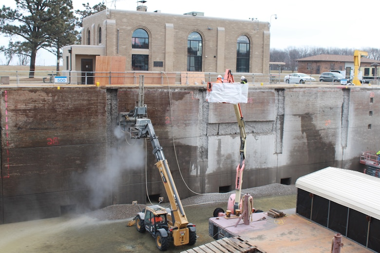 A hydro-demolition machine being used at Lock 17 on the Mississippi River to remove old concrete from the lock walls.