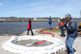John Quick, engineering technician, explains how to properly contain a boil with sandbags during Flood Fight Training.