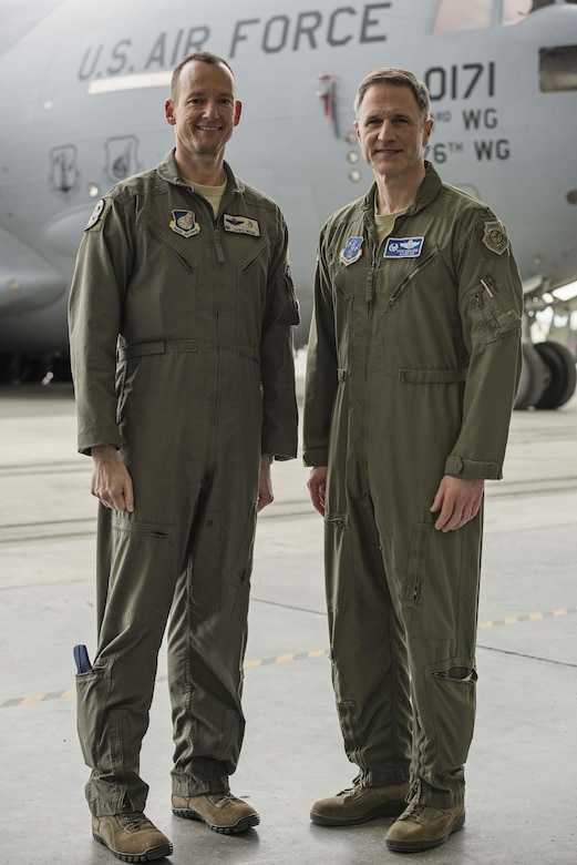 Col. Steven deMilliano, commander of the 176th Wing, Alaska Air National Guard, and Col. Christopher Niemi, commander of the 3rd Wing, U.S. Air Force, commemorated the change of assignment of eight C-17 Globe Master III aircraft based here during a ceremony on Joint Base Elmendorf-Richardson, Alaska, May 17. The two commanders took turns speaking to Airmen from both Wings about the transfer of the aircraft from active duty to the Guard and how the units will continue to support the C-17 mission together in the arctic and Pacific regions. (U.S. Air National Guard photo by Staff Sgt. Edward Eagerton/released)
