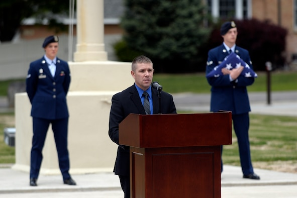 Special Agent Ryan Locklar, Air Force Office of Special Investigations, Detachment 112, speaks during a retreat ceremony May 18 at Hill Air Force Base. The ceremony was part of National Police Week activities. (U.S. Air Force/Todd Cromar)