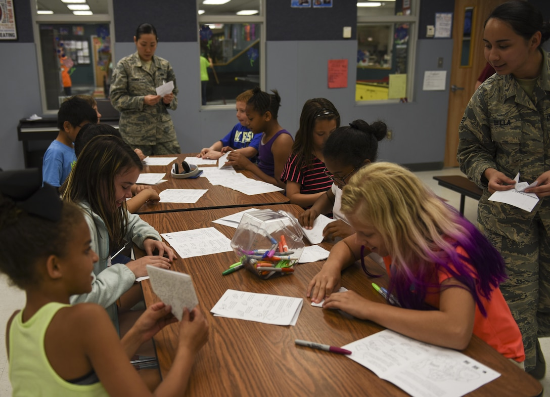 Members of the Asian Pacific American Heritage Association host an origami event for youth during Asian American Pacific Islander Heritage Month at Whiteman Air Force Base, Mo., May 10, 2017. The youth learned how to fold origami frogs, which is a symbol in Japanese culture for good fortune and it is often carried during travel to ensure the individual returns home safely. (U.S. Air Force courtesy photo by Staff Sgt. Rey Jee Quilla)