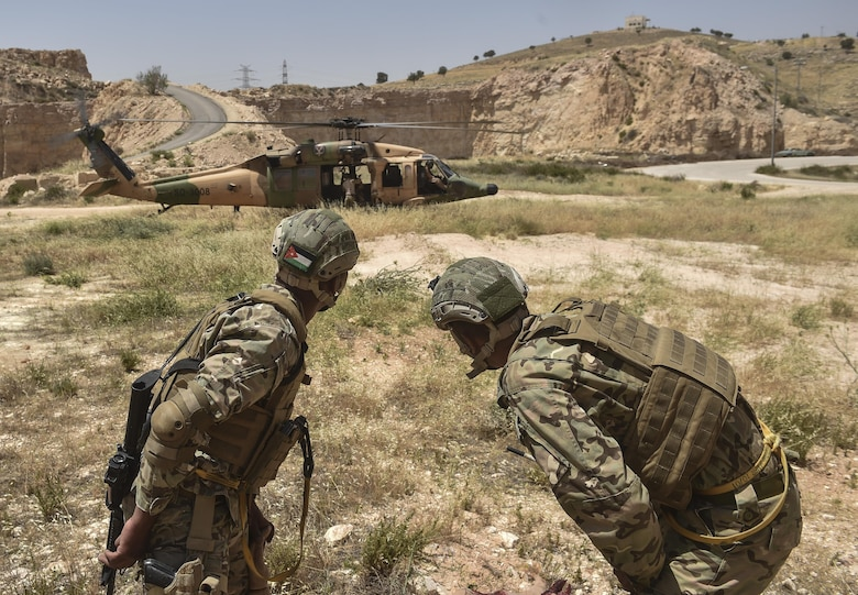 Members of the Jordanian Armed Forces Special Task Force prepare for extraction during a combat search and rescue mission at Eager Lion May 11, 2017, at King Abdullah II Special Operations Training Center. (U.S. Air Force photo by Senior Airman Ryan Conroy)