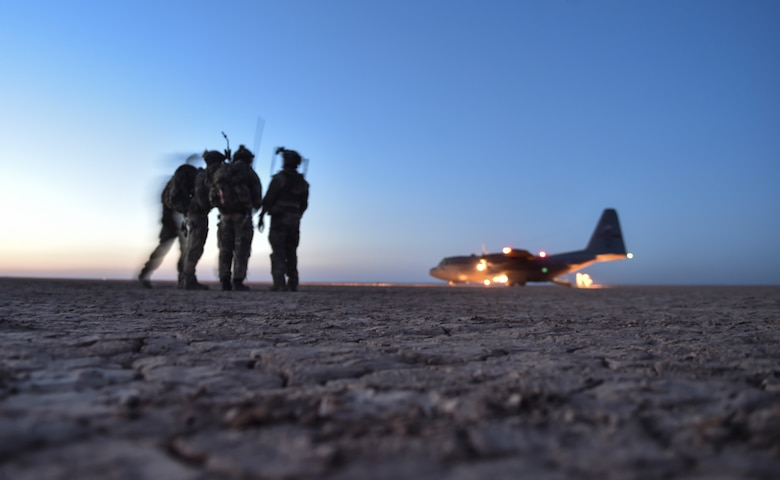 U.S. Air Force Special Tactics Airmen and Italy's 17th Stormo Incursori troops prepare to board an Ohio Air National Guard C-130H Hercules after it landed in a dry lake bed during Exercise Eager Lion, May 16, 2017, in Jordan. The joint special operations team assessed, opened, and controlled clandestine desert landing strip, which helped them train to provide strategic access for U.S. or allied partners. (U.S. Air Force photo by Senior Airman Ryan Conroy)