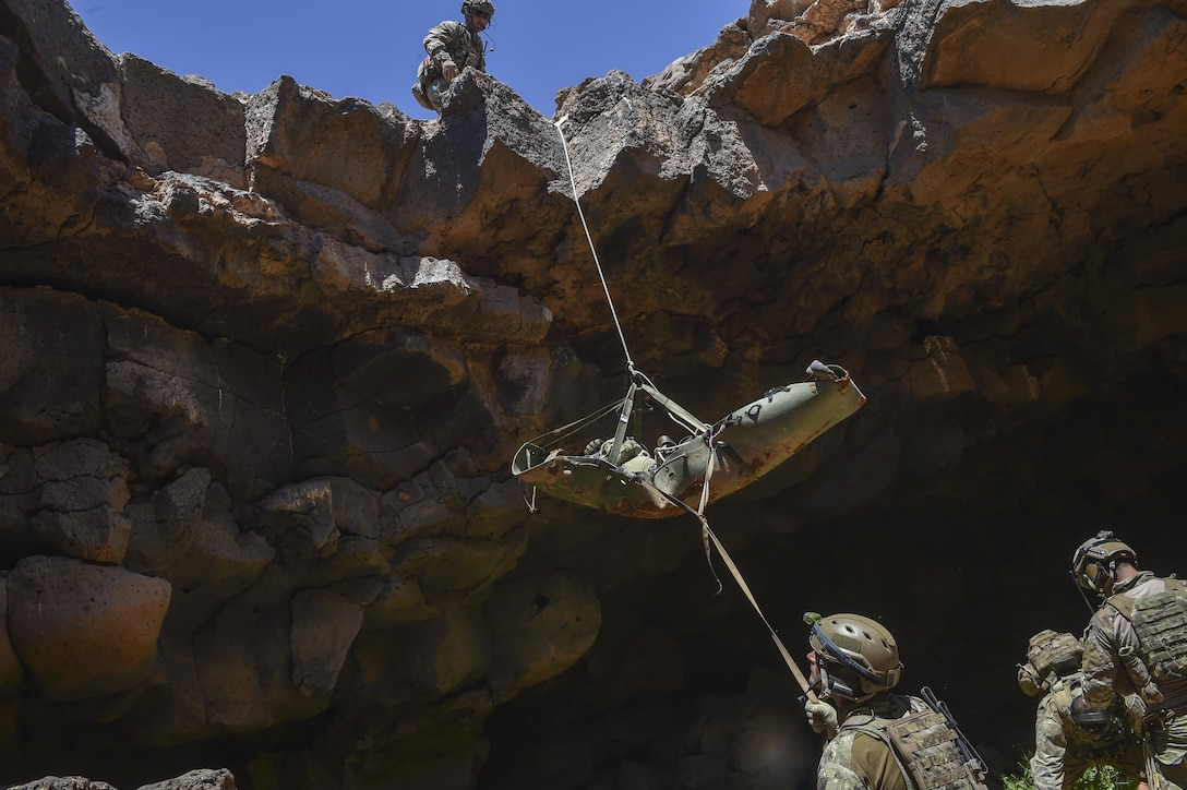 Air Force special tactics Airmen, Jordanian Armed Force Special Task Force and Italian special operations forces pull a simulated casualty out of the Al Biadia Cave Complex during a personnel rescue mission for Eager Lion May 13, 2017, in Mafraq Province, Jordan. Eager Lion is an annual U.S. Central Command exercise in Jordan designed to strengthen military-to-military relationships between the U.S., Jordan and other international partners. This year's iteration was comprised of about 7,200 military personnel from more than 20 nations that responded to scenarios involving border security, command and control, cyber defense and battlespace management. (U.S. Air Force photo/Senior Airman Ryan Conroy)
