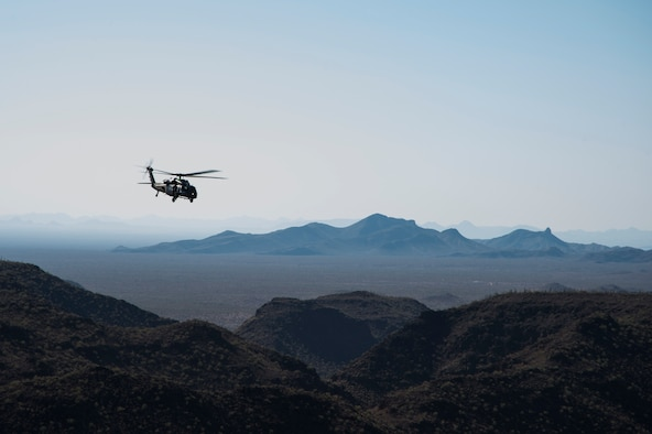 An HH-60 Pave Hawk, assigned to the 66th Rescue Squadron, hovers over the skies of Arizona during a search and rescue scenario at exercise Angel Thunder 17 in Gila Bend, Ariz., May 13, 2017. Angel Thunder is a two-week, Air Combat Command-sponsored, joint certified and accredited personnel recovery exercise focused on search and rescue. The exercise is designed to provide training for personnel recovery assets using a variety of scenarios to simulate deployment conditions and contingencies. (U.S. Air Force photo/Tech. Sgt. Larry E. Reid Jr.)
