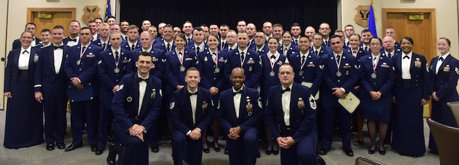 Graduates of Whiteman Airman Leadership School (ALS) class 17-D gather for a class photo after a graduation ceremony at Whiteman Air Force Base, Mo., May 4, 2017. ALS is a five-and-a-half week-long course that prepares senior airmen to supervise and lead Air Force teams, which supports the employment of air, space and cyberspace power. (U.S. Air Force photo by Senior Airman Jovan Banks)