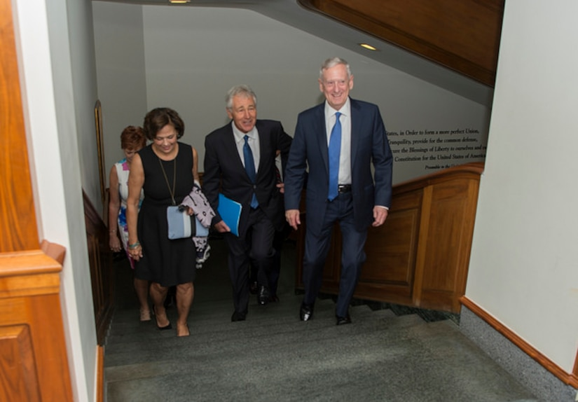 Defense Secretary Jim Mattis walks with former Defense Secretary Chuck Hagel and his family before an office call at the Pentagon, May 19, 2017. Hagel served as the 24th Secretary of Defense from February 2013 to February 2015. DoD photo by Army Sgt. Amber I. Smith