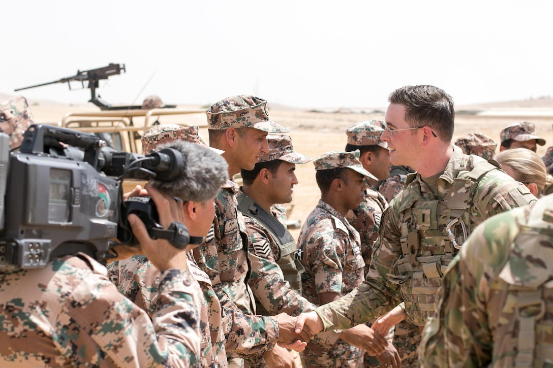 1st Lt. Travis Vaughn, liaison officer, Alpha Battery 5-3 Field Artillery from Joint Base Lewis-McChord, Washington,  shakes hands with Jordan soldiers after a successful exercise. Alpha 5-3 FA along with 29th Royal HIMARS Battalion conducted a High Mobility Artillery Rocket System (HIMARS) live fire exercise, outside Amman, Jordan, May 14, 2017. Eager Lion is an annual U.S. Central Command exercise in Jordan designed to strengthen military-to-military relationships between the U.S., Jordan and other international partners. This year's iteration is comprised of about 7,200 military personnel from more than 20 nations that will respond to scenarios involving border security, command and control, cyber defense and battlespace management. (U.S. Army photo by Sgt 1st Class Steven Queen)