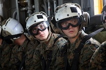 Pfc. Jason Gautreaux (left) and Lance Cpl. Mitch Gautreaux sit together on a CH-53E Super Stallion preparing to fly from Marine Corps Air Station New River, N.C. to Marine Corps Air Station Cherry Point, N.C., May 16, 2017. Both Marines will soon be assigned to units in close proximity to one another after graduating from Squadron Intelligence Training Certification Course. Jason will be assigned to Marine Light Attack Helicopter Squadron 267 at Marine Corps Base Camp Pendleton, California, and Mitch will be assigned to Marine Heavy Helicopter Squadron 465 at Marine Corps Air Station Miramar, California. (U.S. Marine Corps photo by Cpl. Mackenzie Gibson/Released)