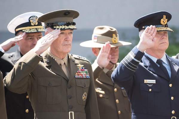 Marine Corps Gen. Joe Dunford, chairman of the Joint Chiefs of Staff, renders honors during a wreath laying ceremony outside NATO Headquarters in Brussels during the Military Committee Meeting, May 17, 2017. The ceremony honored the men and women who have fallen in NATO service. The chiefs of defense met to discuss Afghanistan, countering terrorism and other NATO operations and missions to provide the North Atlantic Council with consensus-based military advice on how to best meet global security challenges. DoD photo by Army Sgt. James K. McCann