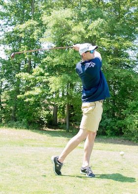 1st Lt. Dillon Heckendorn, 436th Operations Support Squadron intelligence officer, tees off at the 2017 spring Bluesuiters Golf Tournament May 17, 2017, 2016, at the Jonathan's Landing Golf Course in Magnolia, Delaware. Bluesuiters is a biannual golf tournament aimed at connecting Team Dover Airmen with local civic and business leaders. (U.S. Air Force photo by Mauricio Campino)