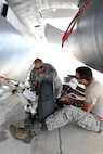 Staff Sgts. Kris Quinonez (left) and Matthew Sanchez, crew chiefs assigned to the 149th Fighter Wing, Air National Guard, change a tire during Coronet Cactus at Davis-Monthan Air Force Base, Ariz., May 8, 2017. Coronet Cactus is an annual training event that takes members of the 149th Fighter Wing, headquartered at Joint Base San Antonio-Lackland, Texas, to Tucson, Arizona to participate in a deployment exercise. (Air National Guard photo by Tech. Sgt. Mindy Bloem)