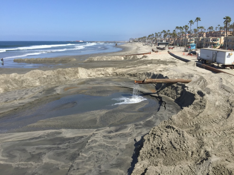 Manson Construction Company places material from the Oceanside Harbor channel dredging project immediately north of the Oceanside Pier. The project is an annual effort to maintain safe navigation for vessels that use the harbor.