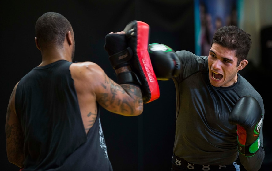 Airman 1st Class Raul Veliz, 90th Missile Security Forces Squadron response force leader, throws punches during practice at Trials Mixed Martial Arts gym in Fort Collins Colo., May 5, 2017. Veliz has been fighting MMA for almost two years. He is stationed at F.E. Warren Air Force Base, Wyo. (U.S. Air Force photo by Staff Sgt. Christopher Ruano)