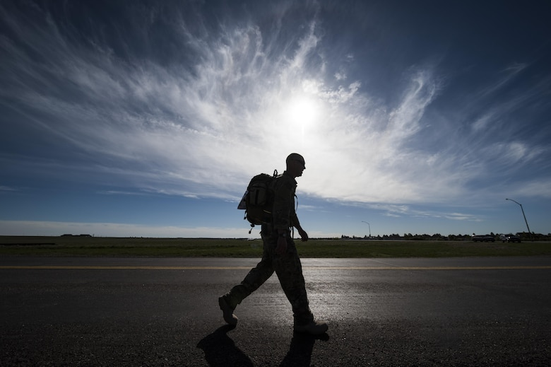 A 90th Security Forces Group defender participates in a ruck march during Police Week at F.E. Warren Air Force Base, Wyo., May 17, 2017. The march was six miles long and more than 50 security forces members participated in the event. (U.S. Air Force photo by Staff Sgt. Christopher Ruano)