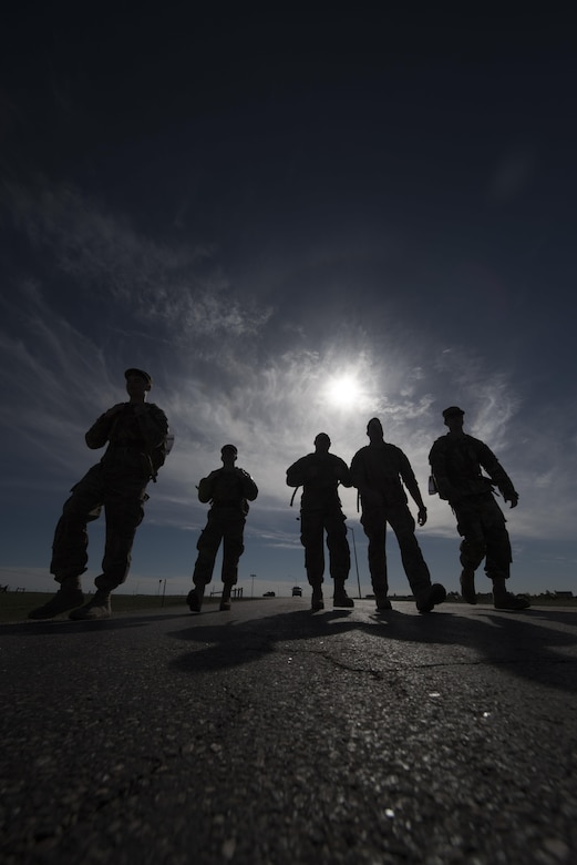 Ninetieth Security Forces Group defenders participate in a ruck march during Police Week at F.E. Warren Air Force Base, Wyo., May 17, 2017. The march was just one event during Police Week and was held to honor law enforcement officers who gave their lives while serving our nation. (U.S. Air Force photo by Staff Sgt. Christopher Ruano)