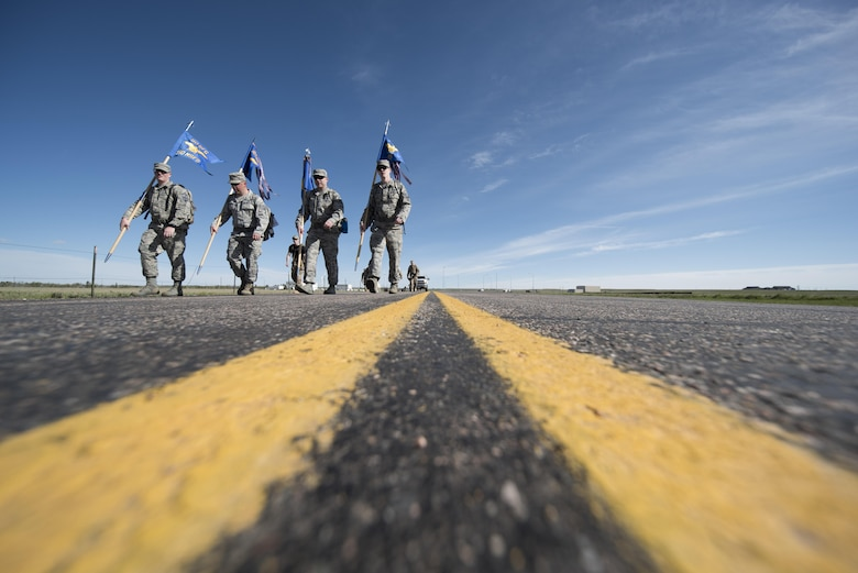 Airmen carry flags from their respective units within the 90th Security Forces Group while participating in a ruck march during Police Week at F.E. Warren Air Force Base, Wyo., May 17, 2017. The 90th SFG hosted several other Police Week events May 15-19, to include the opening ceremony and a shoot-out competition with the local police department. (U.S. Air Force photo by Staff Sgt. Christopher Ruano)