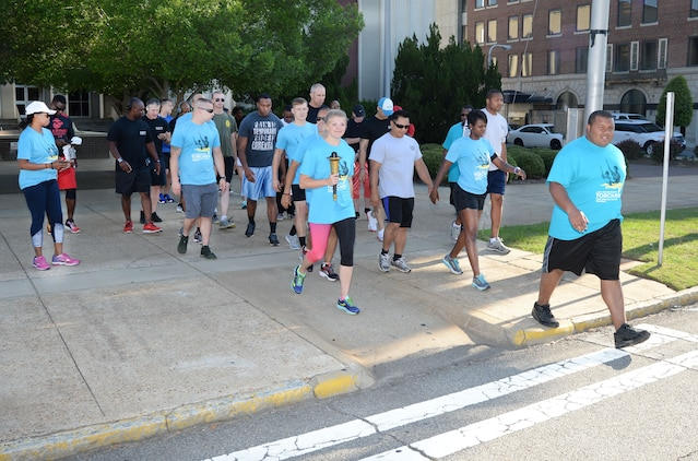 Marine Corps Logistics Base Albany police officers and active-duty service members represent the installation at Albany-Dougherty County's annual 2017 Georgia Law Enforcement Torch Run for Special Olympics, May 16. Lt. Delaney Bourlakov, adjutant, MCLB Albany, carried the ceremonial torch and led the run with fellow-Marine comrades and Marine Corps Police Department personnel in the early morning kickoff and the 5k run, which followed. The day's activities were held to commemorate the annual Law Enforcement Memorial Week, the Torch Run for Special Olympics and to honor fallen officers.