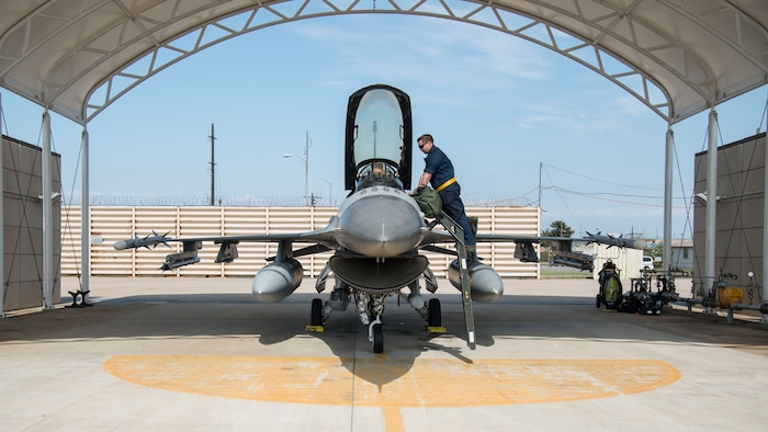 U.S. Air Force Airman 1st Class AJ Kovacs, a 14th Aircraft Maintenance Unit crew chief, talks to U.S. Air Force Capt. Jacob Impellizzeri, a 14th Fighter Squadron F-16 Fighting Falcon fighter pilot, before take-off at Kunsan Air Base, Republic of Korea, May 16, 2017. Team Misawa will have integrated with the 35th and 80th Fighter Squadron's daily operations, to maintain readiness and proficiency and utilize unique training opportunities.