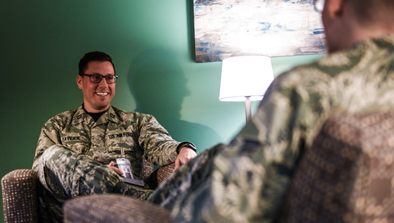 Capt. Luke Davidiuk, 30th Medical Group clinical psychologist, meets with an Airman in his office, May 19, 2017, Vandenberg Air Force Base, Calif. Often thought of as a place to get mental health help when coping is no longer an option, the mental health flight promotes mental well-being by tackling small issues early before they get out of hand and even lead to adverse life and career affects. (U.S. Air Force photo by Senior Airman Ian Dudley/Released)