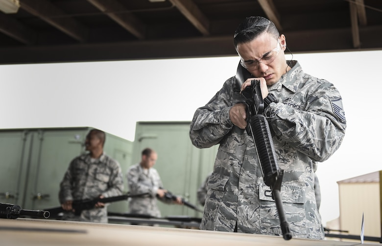 Master Sgt. Sean Roberson, 704th Test Support Squadron checks and assembles his weapon prior to the shooting competition held during National Police Week at Holloman Air Force Base, N.M. on May 15, 2017. National Police Week was established in 1962 by President John F. Kennedy to pay tribute to law enforcement officers who lost their lives in the line of duty for the safety and protection of others, according to the National Peace Officer's Memorial Fund website. Ceremonies are held annually in Washington D.C., as well as in communities across the nation. (U.S. Air Force photo by Staff Sgt. Stacy Jonsgaard)