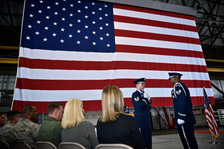 """Members of the 932nd Airlift Wing Honor Guard pay respect to the flag during a flag folding ceremony for retired Lt. Col. Ralph """"Louie"""" DePalma, May 6, 2017, Hangar 1, Scott Air Force Base, Illinois. The tradition of folding a United States flag gives honor to the flag and to the retired service member.   (U.S. Air Force photo by Tech. Sgt. Christopher Parr)"""
