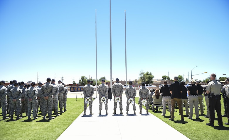 Members from local police departments and Airmen from Holloman Air Force Base Security Forces Squadron participate in a closing ceremony during National Police Week at Holloman Air Force Base, N.M. on May 15, 2017. National Police Week was established in 1962 by President John F. Kennedy to pay tribute to law enforcement officers who lost their lives in the line of duty for the safety and protection of others, according to the National Peace Officer's Memorial Fund website. Ceremonies are held annually in Washington D.C., as well as in communities across the nation. (U.S. Air Force photo by Staff Sgt. Stacy Jonsgaard)
