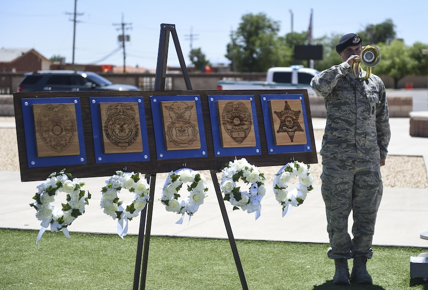 Staff Sgt. Caleb Brooks, 49th Security Forces Squadron, plays taps at the closing ceremony during National Police Week at Holloman Air Force Base, N.M. on May 15, 2017. National Police Week was established in 1962 by President John F. Kennedy to pay tribute to law enforcement officers who lost their lives in the line of duty for the safety and protection of others, according to the National Peace Officer's Memorial Fund website. Ceremonies are held annually in Washington D.C., as well as in communities across the nation. (U.S. Air Force photo by Staff Sgt. Stacy Jonsgaard)