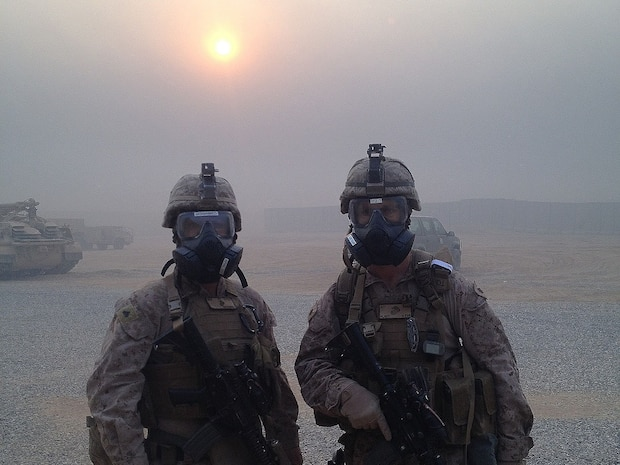 Cpl. Ali J. Mohammed, a translator with the Advise and Assist Team from the Special Purpose Marine Air-Ground Task Force-Crisis Response-Central Command, and Maj. Ryan Hunt, the officer in charge of the A&A Team from the SPMAGTF-CR-CC, pose for a photo at Qayyarah Airfield West, Iraq, Oct. 25, 2016. The Marines of the A&A Team were able to overcome these conditions and continue operating due to their CBRN training. U.S. Marines receive this training throughout their careers and before deploying in order to effectively respond to an attack and continue accomplishing the mission.
