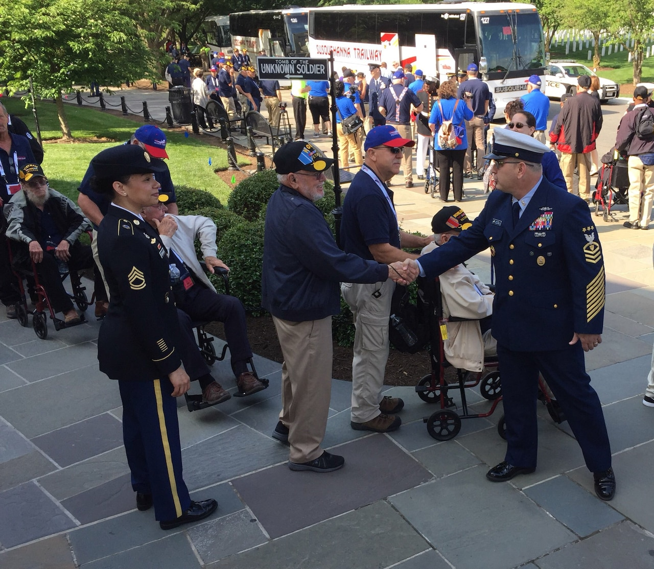 Master Chief Petty Officer of the Coast Guard Steven W. Cantrell meets a Korean War veteran from Midland, Texas, at the Memorial Amphitheater in Arlington National Cemetery, Va., May 20, 2017. DoD photo by Jim Garamone