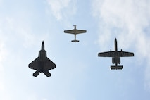 A P-51D Mustang, F-22 Raptor and A-10 Thunderbolt perform a tribute flight during the Wings Over Wayne Air Show, May 21, 2017, at Seymour Johnson Air Force Base, North Carolina. The formation consisted of aircraft dating back to World War II to current 5th-generation aircraft. (U.S. Air Force photo b Airman 1st Class Kenneth Boyton)