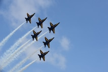 The U.S. Navy Blue Angels fly over Seymour Johnson Air Force Base, North Carolina, May 21, 2017, during the Wings Over Wayne Air Show. The air show was a free, two-day event that featured more than 20 aerial demonstrations, aircraft static displays, military working dog demonstrations and other events. (U.S. Air Force photo by Airman 1st Class Kenneth Boyton)