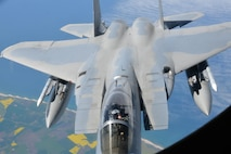 The pilot of an F-15 Eagle from RAF Lakenheath, England, gives a thumbs-up after refueling his aircraft from a KC-135 Stratotanker May 19, 2017. The KC-135 is assigned to RAF Mildenhall, England. Both aircraft are on their way to support Arctic Challenge 2017, a multinational exercise encompassing 11 nations and more than 100 aircraft. (U.S. Air Force photo by Tech. Sgt. David Dobrydney)