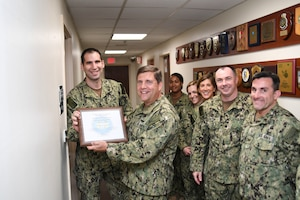 Lt. Cmdr. Allen Linken, a native of Bessemer, Ala., and assigned to Navy Reserve U.S. 5th Fleet (NR C5F) Legal, accepts the 2017 Rear Adm. Hugh H. Howell, Jr. Award of Excellence from Rear Adm. Thomas Marotta, U.S. Naval Forces Central Command (NAVCENT) vice commander, at NAVCENT Headquarters in Manama, Bahrain. NR C5F Legal is recognized for their ingenuity and flexibility in resolving gapped-manning issues and providing U.S. stateside collaborations for operational and international law. (U.S. Navy photo by Mass Communication Specialist 2nd Class Kevin J. Steinberg)